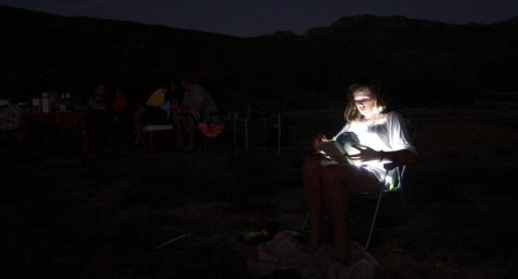 Nicole, reading with the fairy lights... maybe it is time to go home.. as the walk back to the vehicles will be dark...